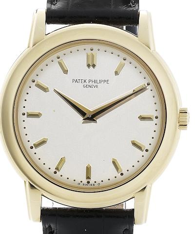 Patek Philippe. A fine 18ct gold automatic wristwatch with Certificate of OriginRef:5032, Case No.2998030, Movement No.1200500, Sold 20th December 1996