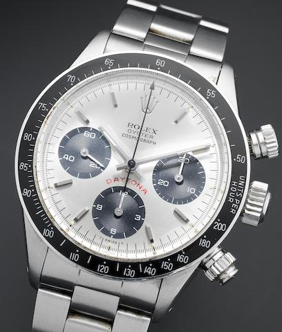 Rolex. A stainless steel chronograph bracelet watch together with Rolex box, punched guarantee paper and original receipt Rolex Cosmograph Daytona, Ref:6263, Serial No.558***, Sold 24th of February 1982