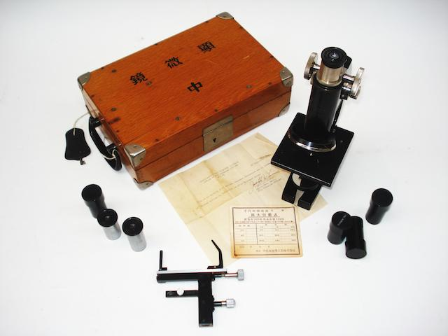 A Tiyoda compound monocular field microscope,  Japanese,  1930's,
