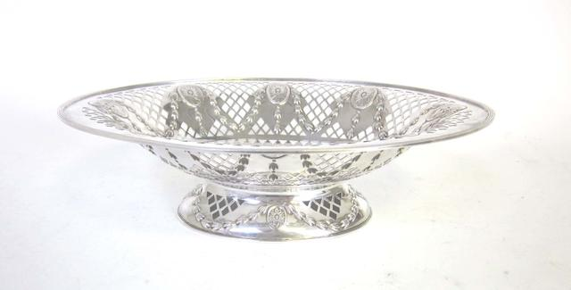 A  silver pierced basket by Atkin Bros, Sheffield 1902; together with a modern pair of candlesticks, and a small assortment of flatware  (8)