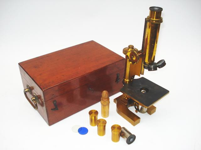 A small Ross brass monocular microscope, English, late 19th century,