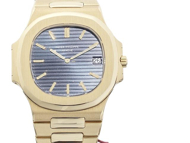 Patek Philippe. An 18ct gold automatic calendar bracelet watch together with Patek Philippe wallet Jumbo Nautilus, Ref:3700, Case No.543029, Movement No. 1310420, Sold 30th July 1982