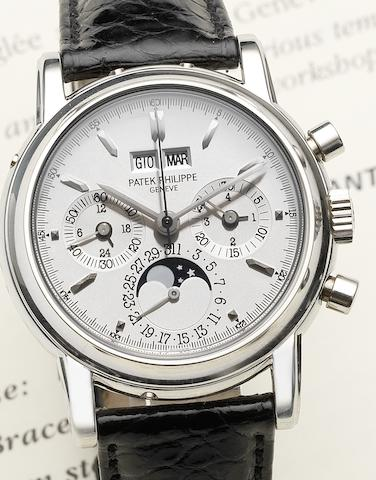 Patek Philippe. A very fine and rare platinum manual wind chronograph wristwatch with moon phases and leap year indication together with Certificate of Origin and Patek Philippe boxRef:3970, Case No.4103686, Movement No.3046141, Circa 1998