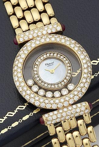 Chopard. A lady's 18ct gold, ruby and diamond set quartz bracelet watchHappy Diamonds, Ref:20/6211-21, Sold at Grimoldi's, Milan, 30th March 2000