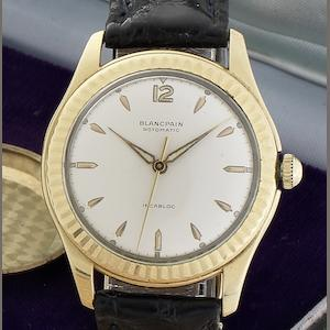 Blancpain, Horologers a Villeret. A rare 18ct gold automatic wristwatch together with original box Circa 1965