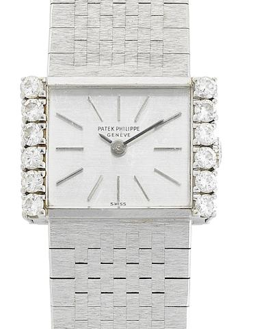 Patek Philippe. An 18ct white gold and diamond set manual wind lady's wristwatch Ref:3368/2, Case No.2665014, Movement No.992435, Circa 1969