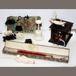 A Japanese Kobe wooden toy together with four ivory carvings, a white metal book mark and a set of oriental miniature dollsEarly 20th century