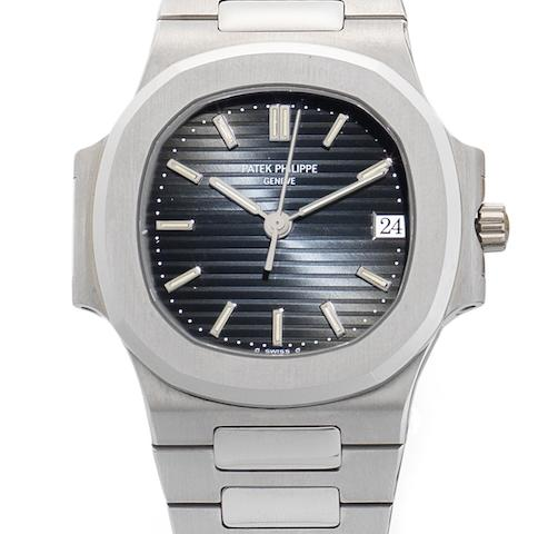 Patek Philippe. A stainless steel automatic calendar bracelet watch together with Patek Philippe box Nautilus, Ref:3800/001, Movement No.1931931, Sold 21st July 1994