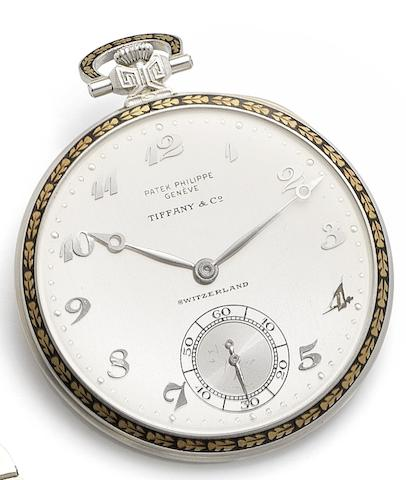 Patek Philippe. A very fine platinum and gilt-enamel manual wind open face pocket watch Retailed by Tiffany & Co., Case No.604618, Movement No.813786, Circa 1920
