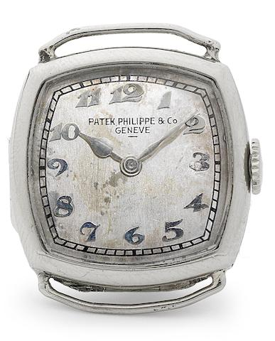 Patek Philippe. A lady's rare 18ct white gold cushion shaped wristwatch together with the Extract from Archives Case No.603513, Movement No.810.358, Made in 1925, Sold April 17th 1934