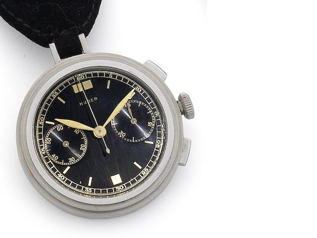 Universal. An unusual and rare manual wind stainless steel chronograph lapel watch  Retailed by Huber, Circa 1940
