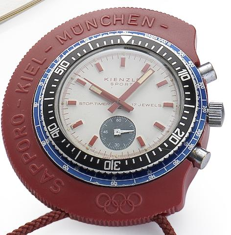 Kienzle. A stainless steel manual wind chronograph stop-timer in red plastic case Sport Olympic, Circa 1972