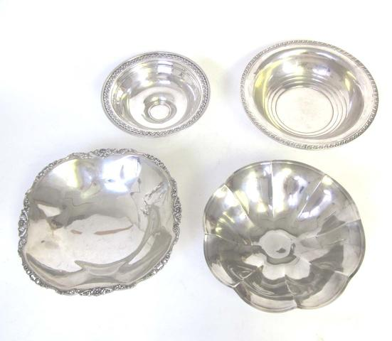 "A North American metalware fruit bowl incuse stamped on base ""Sterling SIlver""  together with three others(4)"