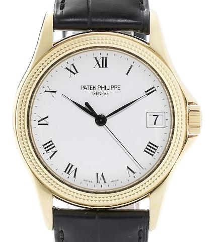 Patek Philippe. An 18ct gold automatic calendar wristwatch with Certificate of Origin  Ref:5117J, Case No.4236889, Movement No.3255563, Sold 14th July 2004
