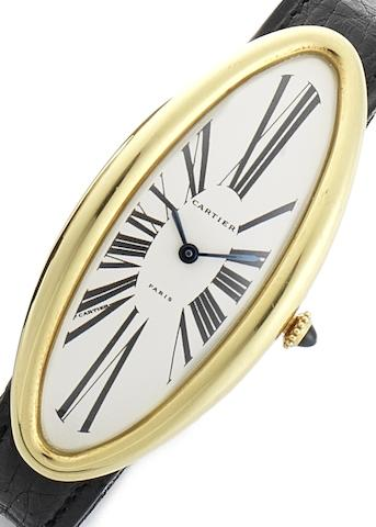 Cartier. An 18ct gold elongated oval shaped wristwatchBaignoire Oval Maxi, Circa 1970