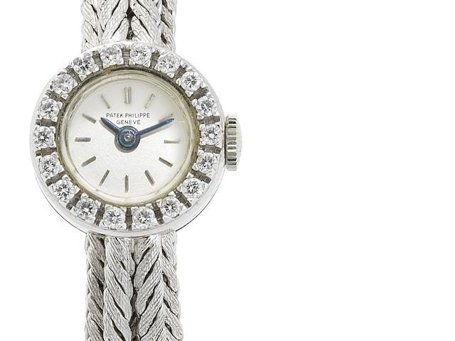 Patek Philippe. A lady's fine 18ct white gold and diamond set manual wind bracelet watch Ref:3267/76, Case No.2612065, Movement No.980580, Circa 1960