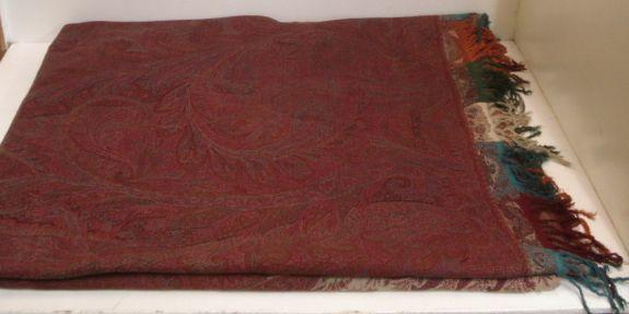 A 19th Century Paisley shawl, fringed,approximately 320 x 165cm.