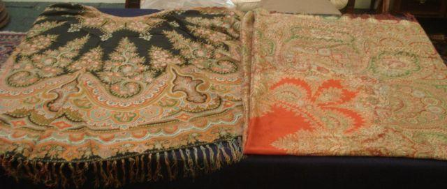 A 19th Century paisley shawl, fringed, approximately 170cm, square, and a Paisley cape. (2)