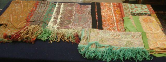 A collection of six printed Paisley and other shawls, and a silk stole. (7)