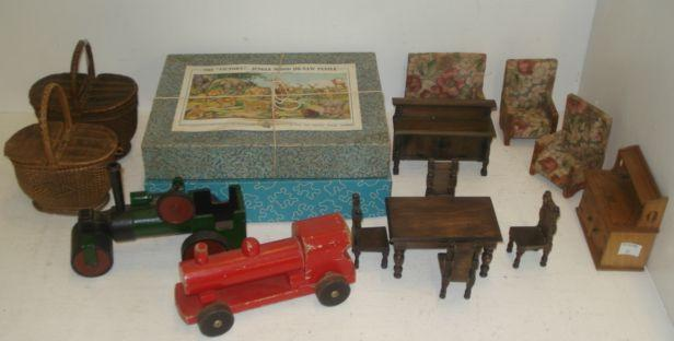 A vintage painted wooden push-a-long steam roller, 19cm, red painted Remanco locomotive, a collection of vintage dolls house furniture to include an 'oak' dining room suite and three brass fenders, Victorian wooden jigsaw puzzles and two small baskets.