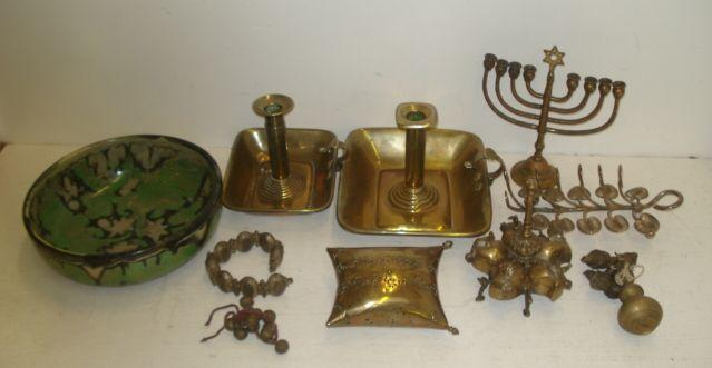 Two Georgian brass chamber candlesticks, with rectangular tray base, brass spice box, other brassware, collection of Tibetan bells, an electroplate novelty toast rack and other items.