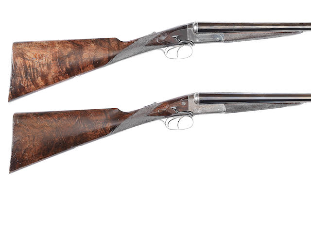 A composed pair of 12-bore boxlock ejector guns by William Powell & Son, no. 10523/11835 In their brass-mounted leather case (handle replaced and partially detached)