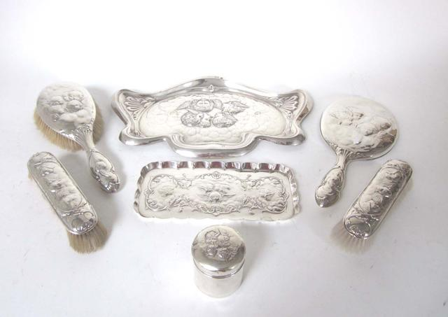 An Edwardian five-piece  silver mounted dressing table set by William Comyns, Birmingham 1904-08, together with two further matched items (7)