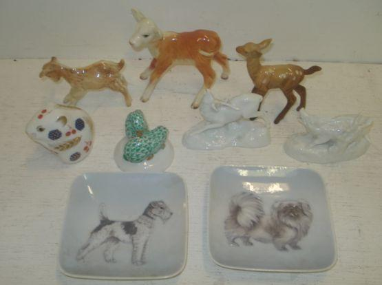 A pair of Meissen blanc de chine figures of a Stag and Boar, on naturalistic bases, three Beswick figures of animals, Herend figure of hares, Royal Crown Derby mouse and a pair of Royal Copenhagen square dishes. (9)