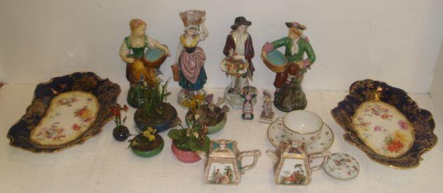 A pair of Dresden miniature teapots, decorated in the Helena Wolfshon workshop with romantic figure panels, two Hammersley & Co floral painted dessert dishes, pair of Stizendorf figurines, four others, five model jardineres of flowers and other ceramics.