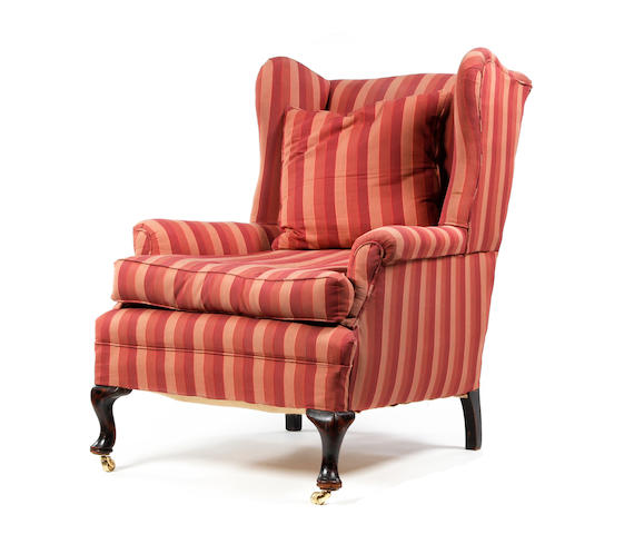 A mid-18th century style beech-framed wing armchair