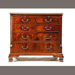 A George III mahogany chest of drawers with brushing slide