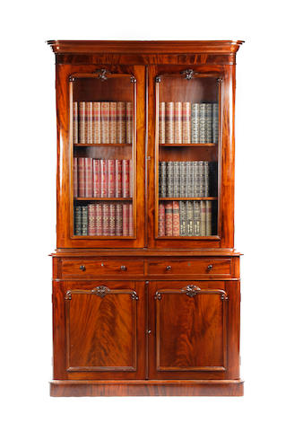 A Victorian mahogany library bookcase cabinet
