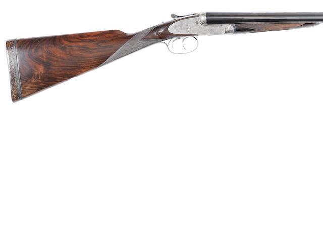 A 12-bore self-opening sidelock ejector gun by J. Purdey & Sons, no. 15747 In a leather case