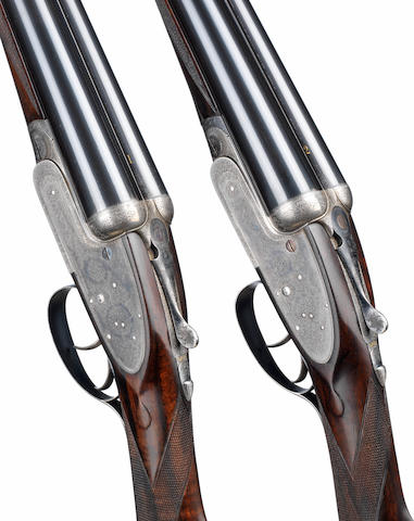 A fine pair of 12-bore self-opening sidelock ejector guns by J. Purdey & Sons, no. 13992/3  The guns in their brass-mounted oak and leather case (handle partially detached), the additional barrels in a brass-mounted oak and leather case with J. Purdey & Sons trade-label