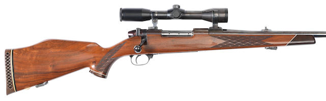 A .378 (Weatherby Magnum) 'Mark V' sporting rifle by Weatherby, no. P57803  The telescope-sight with a leather case
