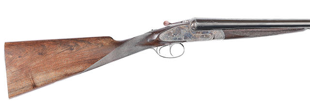 A 12-bore (2¾in) 'The Sandhurst' sidelock ejector gun by P. Arrizabalaga, no. 14463 For J. Rigby & Co. In a Brady canvas case