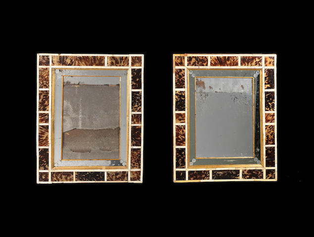 A pair of Flemish parcel-gilt, ivory and tortoiseshell mirrors