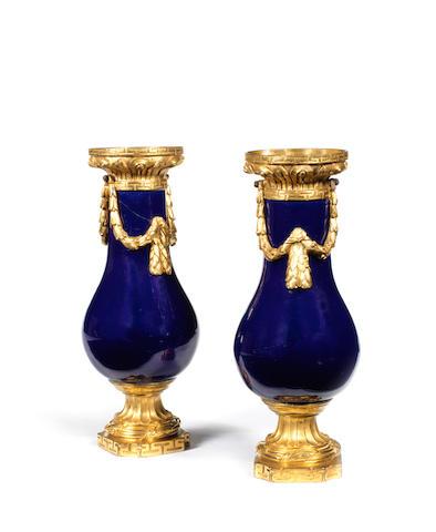 A pair of French 18th century Louis XVI ormolu-mounted 'bleu-nuit' porcelain vases
