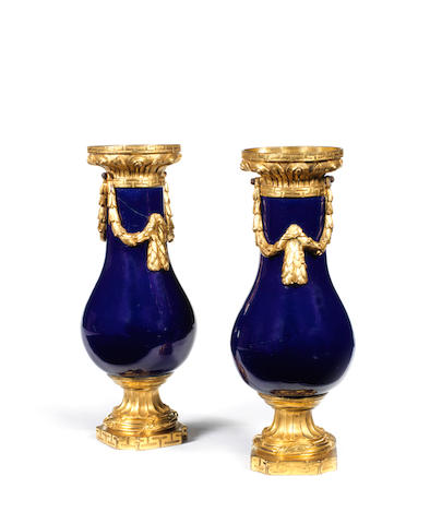 A pair of small Louis XVI ormolu mounted blue vases