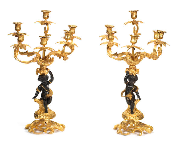 Pair of mid-19th century gilt and patinated candelabras with cherubs