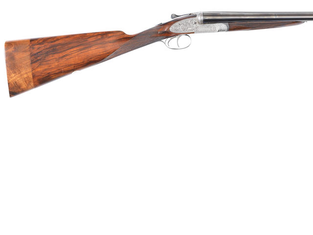 A 12-bore 'Imperial' sidelock ejector gun by E.J. Churchill, no. 6547 In a brass-mounted leather case with reproduction Churchill trade-label