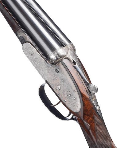 A 12-bore self-opening sidelock ejector gun by J. Purdey & Sons, no. 24997 In its brass-mounted oak and leather case