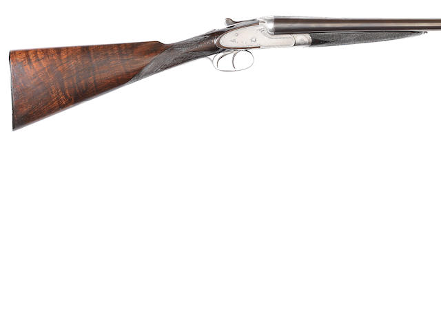 A 12-bore (2¾in) 'W & R Plain Hammerless Ejector' sidelock ejector gun by Charles Lancaster, no. 11593 In a relined leather case (handle partially detached)