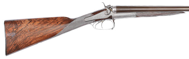 A 12-bore hammer gun by F. Gates, no. 981 In a leather case (handle partially detached)