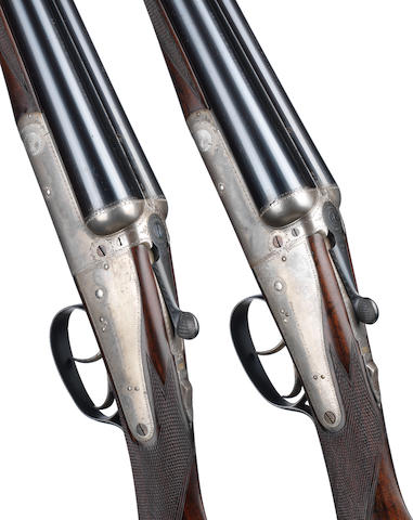 A pair of 12-bore 'No. 3 Model' backlock ejector guns by Holland & Holland, no. 32266/7 In a Holland & Holland brass-mounted oak and leather case for Royals no. 25157/8