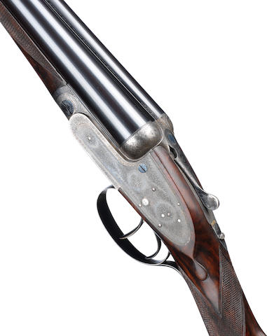 A 12-bore self-opening sidelock ejector gun by J. Purdey & Sons, no. 16638 In a later J. Purdey & Sons leather motor-case