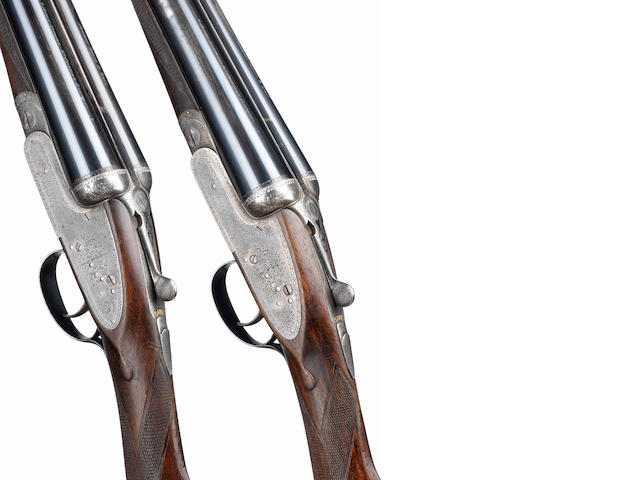 A pair of 12-bore sidelock ejector guns by Joseph Lang & Son, no. 13557/8 In their brass-mounted leather case