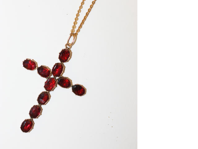 A garnet cross pendant,