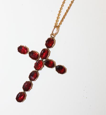 A garnet cross pendant,