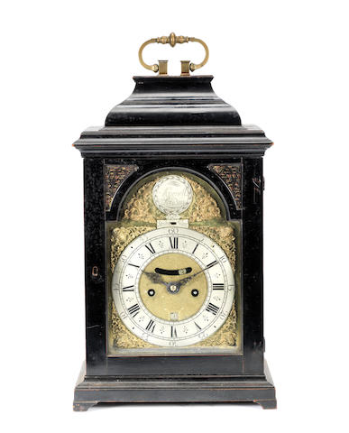 A good mid 18th century ebonised quarter repeating table clock Avenell, London